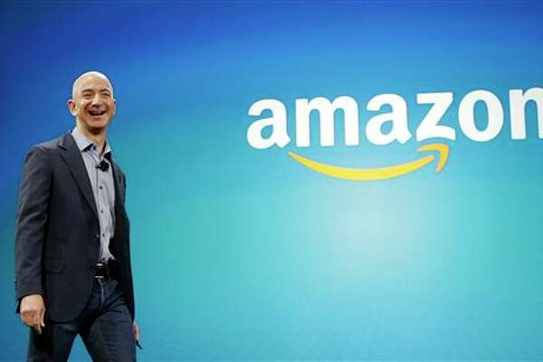FILE - In this June 16, 2014 file photo, Amazon CEO Jeff Bezos walks on stage for the launch of the new Amazon Fire Phone, in Seattle. (AP Photo/Ted S. Warren, File)