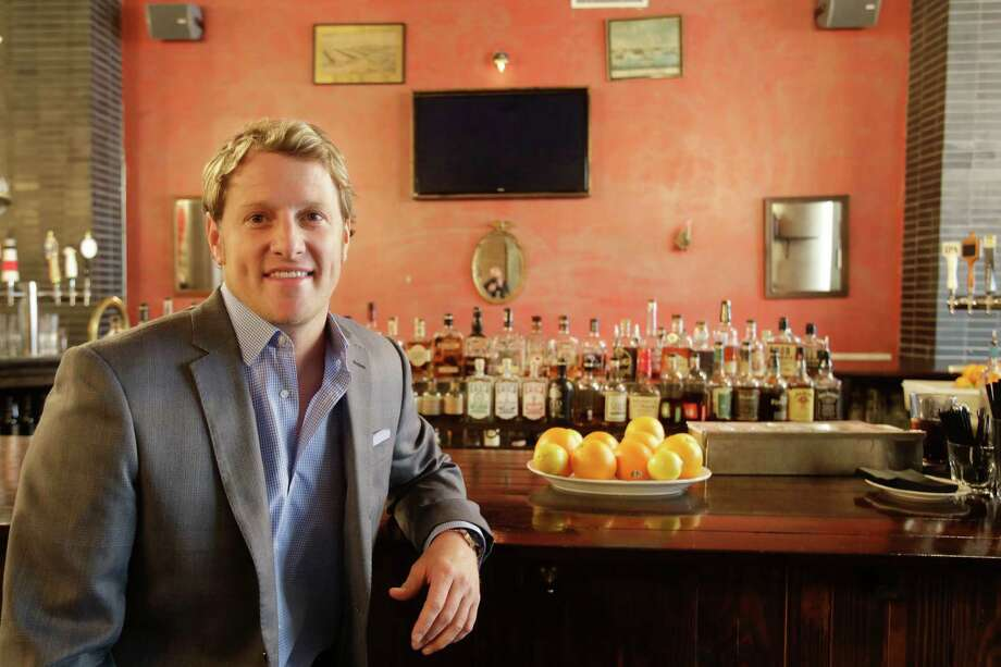 In this Dec. 16, 2014 photo, Jayson Seaver poses for a photo in New York's Harding's restaurant, of which he is a part owner. Seaver feels the wealth gap has affected his relationship with his sister. (AP Photo/Mark Lennihan) Photo: Mark Lennihan, STF / AP