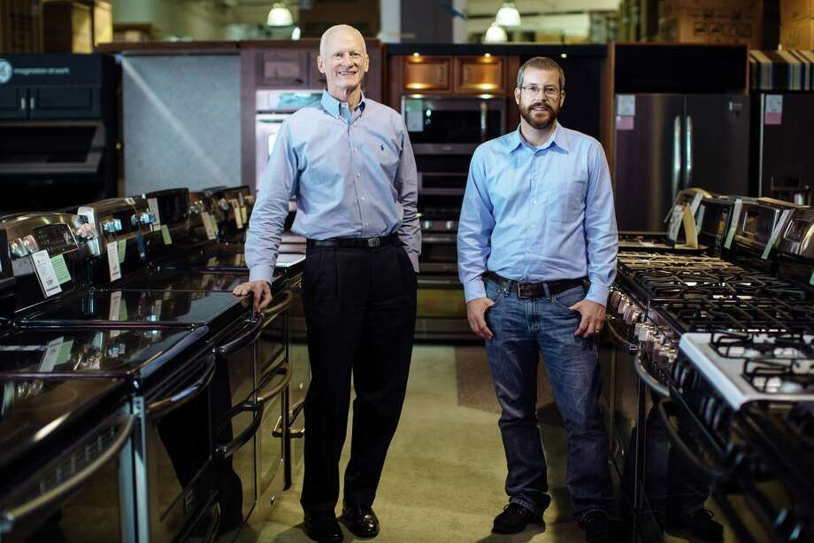 """Steve Goedecker (left), the owner of an appliance retail store, with Matt Davids, Goedecker's search engine optimization manager. Goedecker and his family built a website in 2008, a move that saw sales and payroll greatly; but by late 2013, they were looking for ways to escape what Goedecker calls """"the never-ending treadmill"""" of paid ads. They've turned to content marketing. Photo: Whitney Curtis /New York Times / NYTNS"""