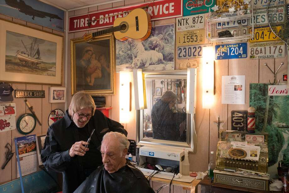 Gordon Vann of Frenchy's Barber Shop has many customers who have been coming to you for years, such as Ernest Bradley of Braeburn Valley. Photo: R. Clayton McKee, Freelance / © R. Clayton McKee