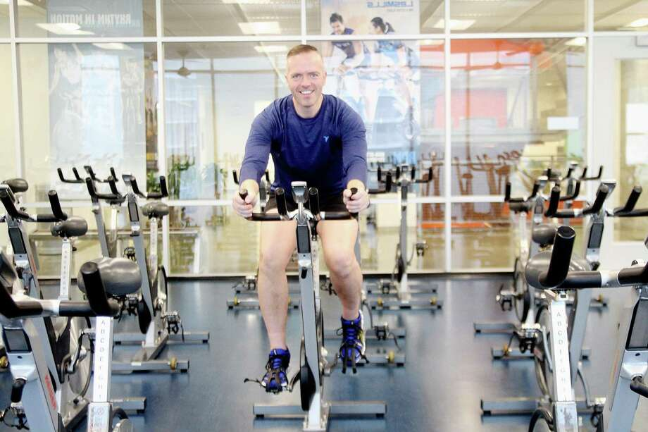 Paul Pettie, who  lost about 160 pounds, keeps a strict exercise regimen. He trains at the Tellepsen Family Downtown YMCA. Photo: Pin Lim, Freelance / Copyright Pin Lim.