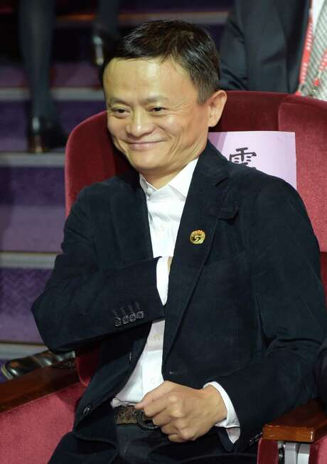 Jack Ma, the founder of the Alibaba group, smiles during the 2014 Cross-Strait CEO Summit in Taipei on December 15, 2014. Anti-Beijing protesters chanted outside a high-level business meeting in Taiwan on December 15 where founder of China's e-commerce giant Alibaba called on the island's youth to start businesses on the mainland. AFP PHOTO / SAM YEHSAM YEH/AFP/Getty Images Photo: SAM YEH, Staff / AFP