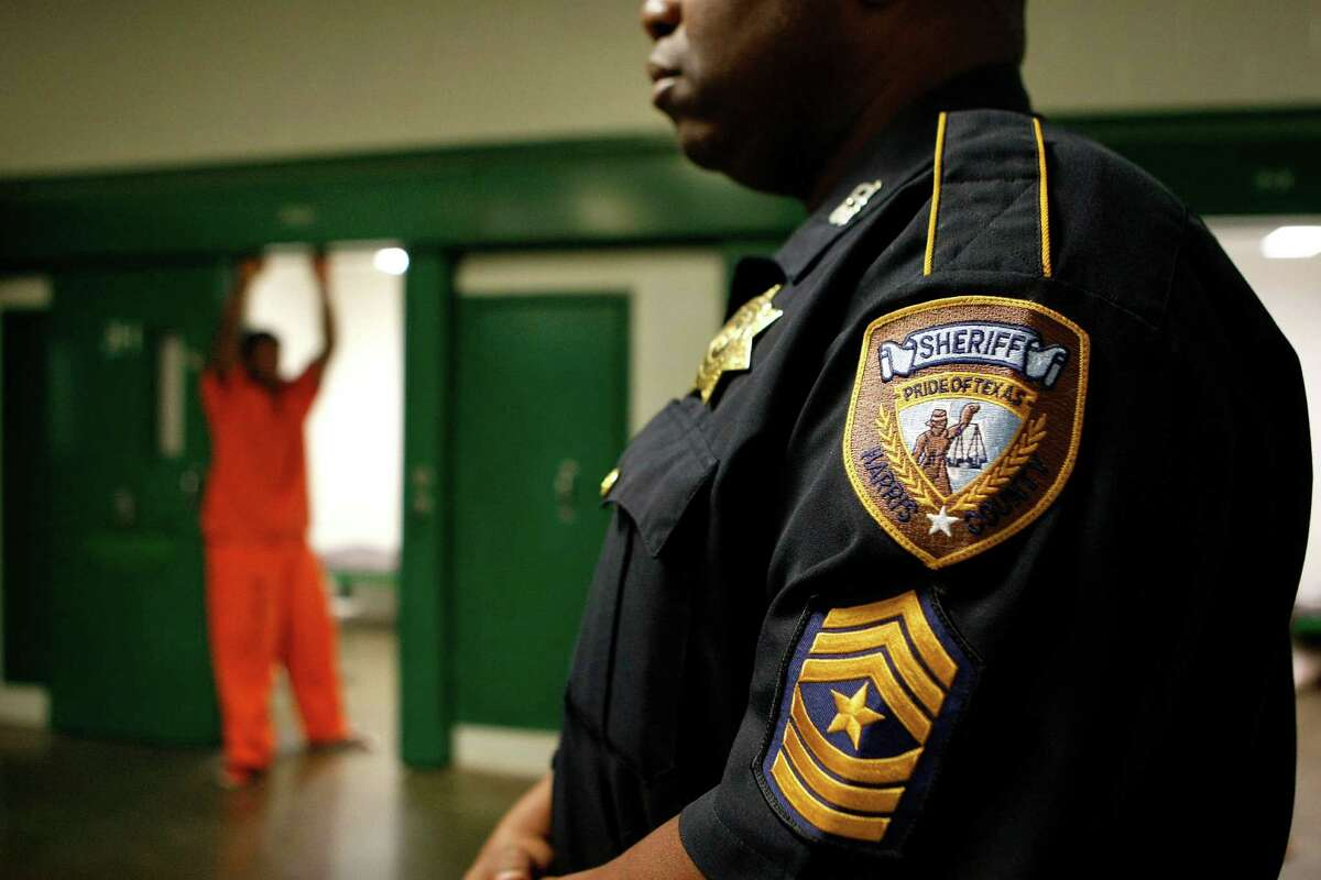 Sgt. Roosevelt Berry looks on as a juvenile stands in his cell at the Harris County Jail on 1200 Baker St. Friday, May 11, 2012, in Houston. The United States has the world's largest confined population of adults and youth, and the highest incarceration rates in the world. ( Johnny Hanson / Houston Chronicle )