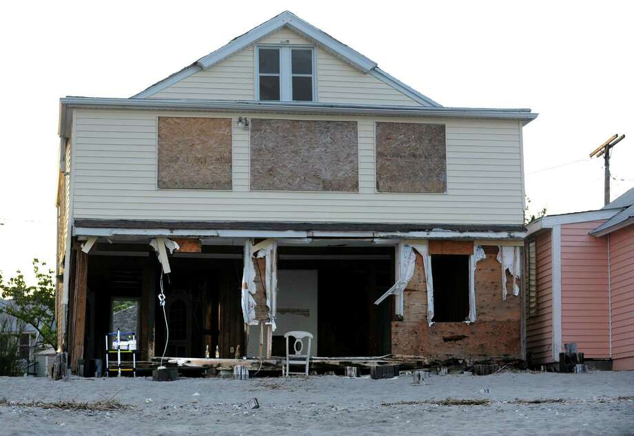 Federal money to shore up the timber bulkhead in the Penfield Beach area would help the neighborhood better withstand the ravages of severe coastal storms. This house was damaged by Superstorm Sandy. Photo: Cathy Zuraw, File / Connecticut Post
