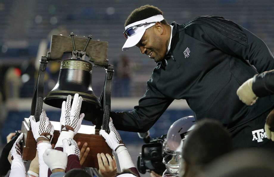 Texas A&M head coach Kevin Sumlin rings the Liberty Bell trophy after beating West Virginia in the Liberty Bowl on Monday, Dec. 29, 2014, in Memphis, Tenn. Texas A&M won 45-37. Photo: Mark Humphrey /Associated Press / AP