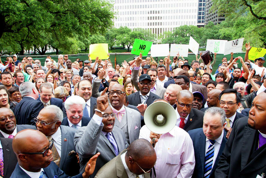 Protesters gathered outside City Hall last year during the City Council debate over the equal rights ordinance. Now the issue is bound for the ballot, and opponents have released their first radio spot.  Photo: Cody Duty, Staff / Â 2014 Houston Chronicle