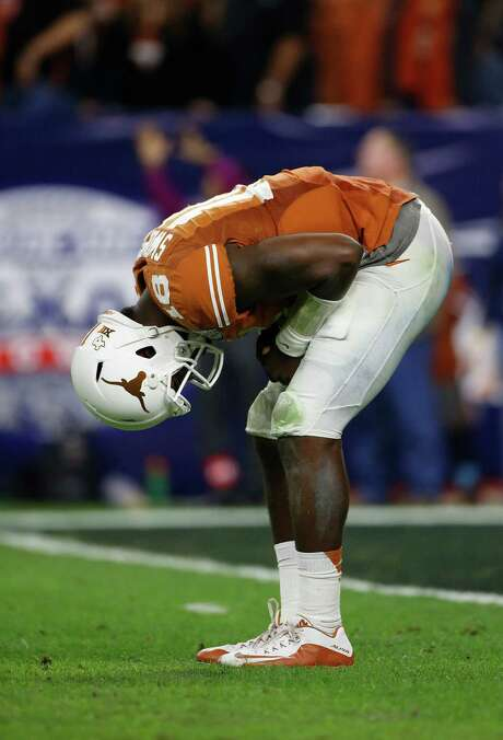 UT quarterback Tyrone Swoopes was in pain after a third-quarter hit Monday, but the lack of production by the Longhorns' offense also had to sting. Photo: Karen Warren, Staff / © 2014 Houston Chronicle