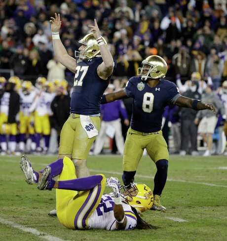 Notre Dame kicker Kyle Brindza, left, and LSU's Jalen Collins reflect the teams' up-and-down moods after Brindza's game-winning field goal. Photo: Mark Humphrey, STF / AP