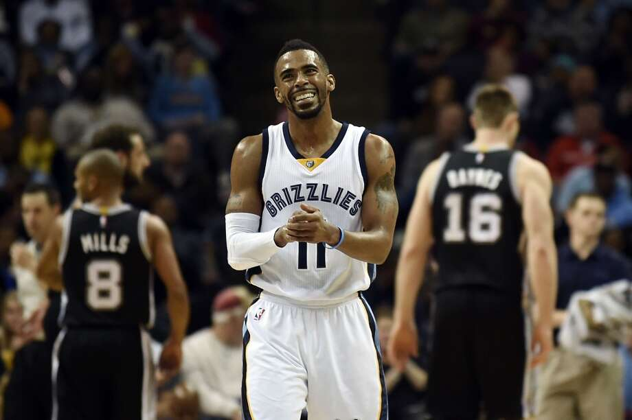 MEMPHIS, TN - DECEMBER 30:  Mike Conley #11 of the Memphis Grizzlies reacts to a called foul against the San Antonio Spurs during the second quarter of a game at the FedExForum on December 30, 2014 in Memphis, Tennessee.  NOTE TO USER: User expressly acknowledges and agrees that, by downloading and or using this photograph, User is consenting to the terms and conditions of the Getty Images License Agreement.  (Photo by Stacy Revere/Getty Images) Photo: Getty Images