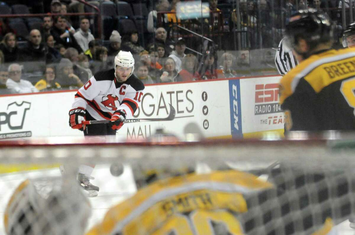 Devil Rod Pelley takes a shot on net during their game against the Providence Bruins at the Times Union Center on Tuesday Dec. 30, 2014 in Albany, N.Y. (Michael P. Farrell/Times Union)
