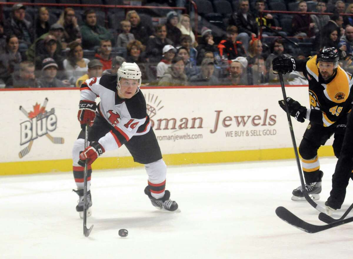Devil's left winger Reid Boucher looks to pass during their game against the Providence Bruins at the Times Union Center on Tuesday Dec. 30, 2014 in Albany, N.Y. (Michael P. Farrell/Times Union)