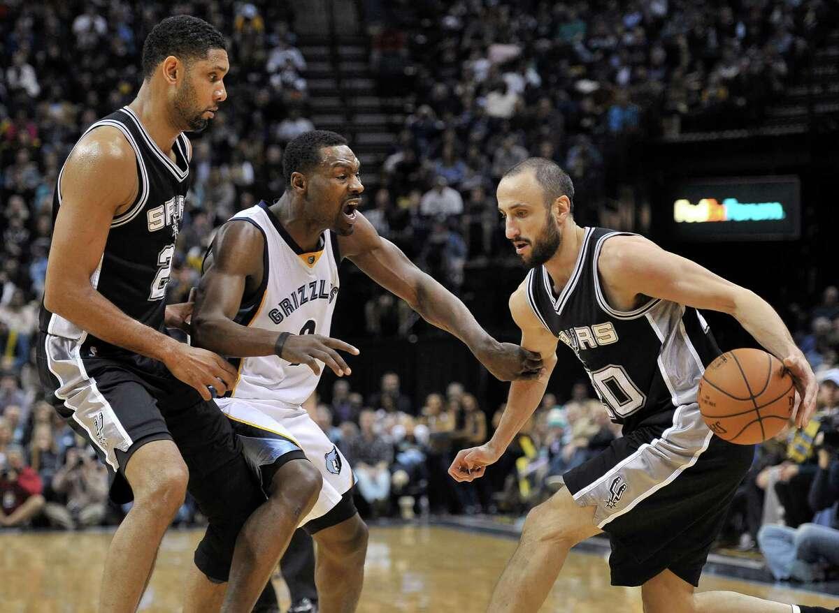 Spurs guard Manu Ginobili drives against Memphis Grizzlies guard Tony Allen, center, while Tim Duncan sets a pick during the second half on Dec. 30, 2014, in Memphis, Tenn.