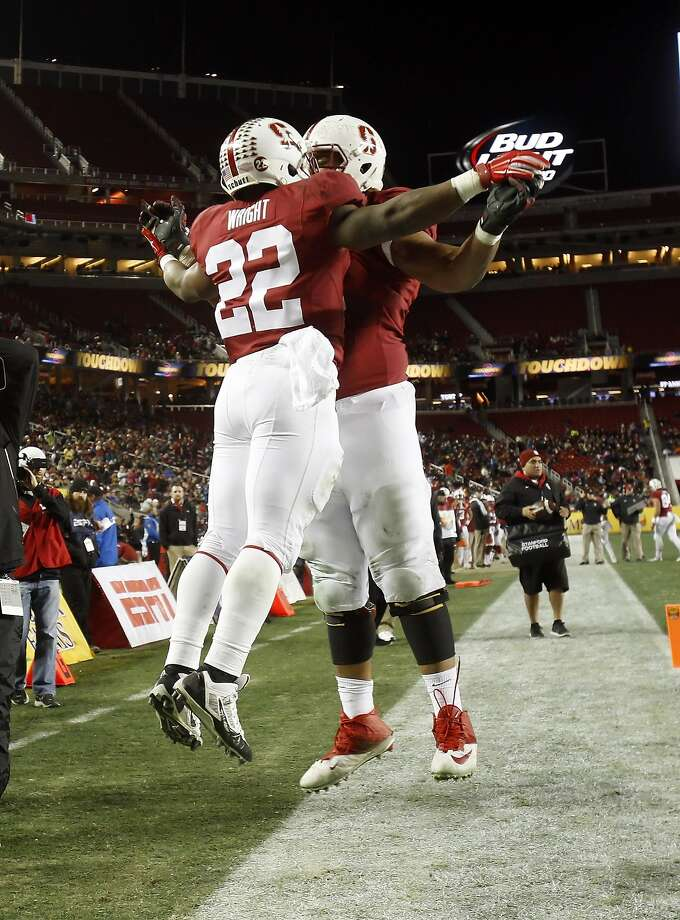 Remound Wright (22) celebrates his second quarter touchdown with Joshua Garnett (51). Stanford Cardinal played the Maryland Terrapins at Levi's Stadium in Santa Clara, Calif., in the 2014 Foster Farms Bowl on Tuesday, December 30, 2014. Photo: Carlos Avila Gonzalez, The Chronicle