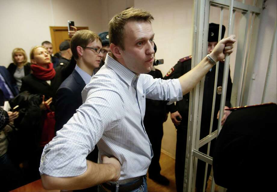 Opposition activist and anti-corruption crusader Alexei Navalny, 38, stands in court in Moscow. Photo: Pavel Golovkin /Associated Press / AP