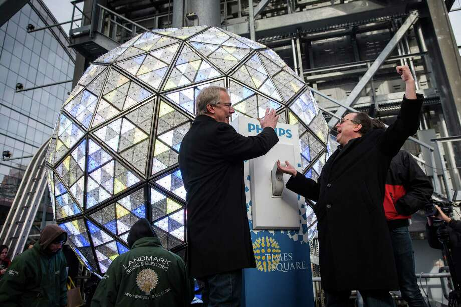 Brent Shafer, CEO of Philips North America (left), and Jeffrey Straus, president of Countdown Entertainment, test flipping the switch on the Times Square crystal ball. Photo: Andrew Burton /Getty Images / 2014 Getty Images