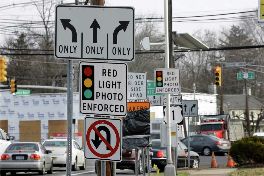 Motorists are seeing fewer signs like these, but now are faced with speed cameras. Photo: Mel Evans /Associated Press / AP