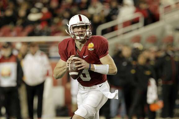 Kevin Hogan (8) looks for an open receiver in the second quarter. Stanford Cardinal played the Maryland Terrapins at Levi's Stadium in Santa Clara, Calif., in the 2014 Foster Farms Bowl on Tuesday, December 30, 2014.