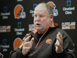 Cleveland Browns president Mike Holmgren speaks about quarterback Colt McCoy's concussion during a news conference at the NFL football team's headquarters in Berea, Ohio Wednesday, Dec. 14, 2011. Holmgren says McCoy was not checked for a concussion while he was on the sideline after helmet-to-helmet hit by Pittsburgh's James Harrison. (AP Photo/Mark Duncan)