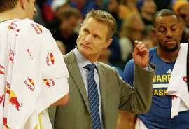 Golden State Warriors head coach Steve Kerr reacts during the first half of the basketball game on Tuesday, December 30, 2014 in Oakland, Calif.