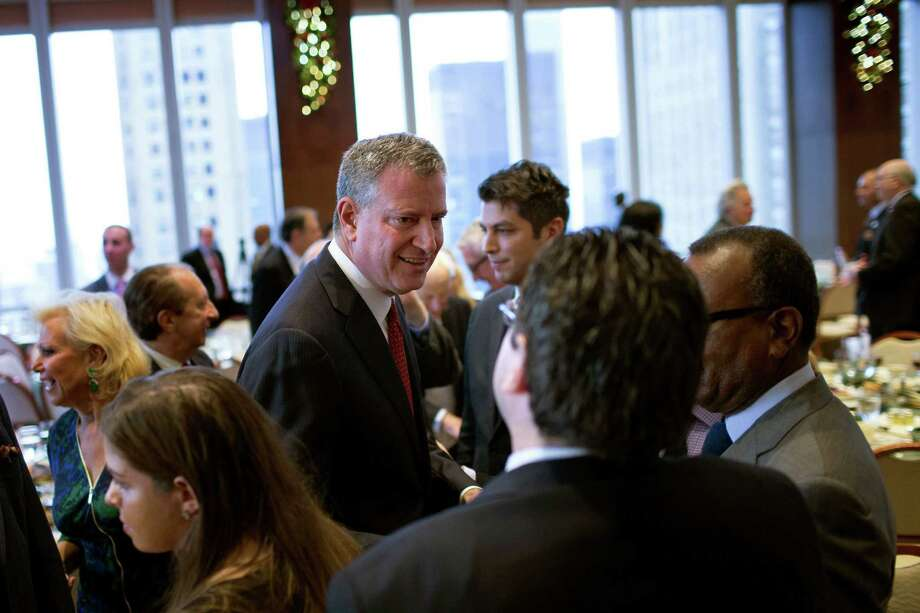 New York City Mayor Bill de Blasio greets people during a Police Athletic League luncheon. De Blasio delivered remarks about strengthening the bond between police and the community, but his relationshoip with police is severely strained. Photo: Kevin Hagen /Associated Press / Wall Street Journal Pool