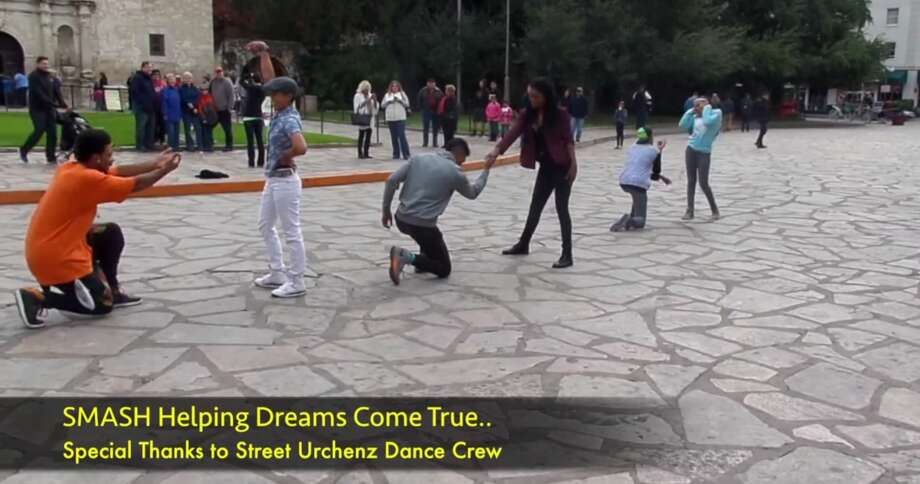 """A woman named Karli said """"yes"""" to a marriage proposal in Alamo Plaza after now-fiancé Louie hired a local dance crew to perform a dance to Bruno Mars' """" Marry Me."""" Photo: Fechter, Joshua I, Screenshot Via YouTube"""
