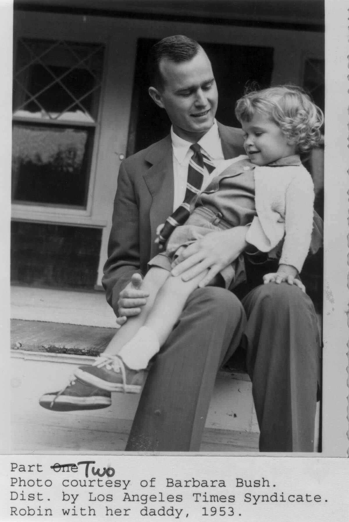 Robin Bush with her daddy in 1953. She died of leukemia the same year.
