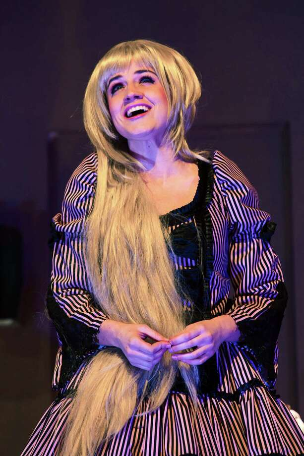 "Stages' ""Panto Rapunzel"" stars Kathryn Porterfield as the fairy-tale heroine who has a surfeit of hair but a shortage of ladders.  Photo: Bruce Bennett / Bruce Bennett 2014 and beyond"