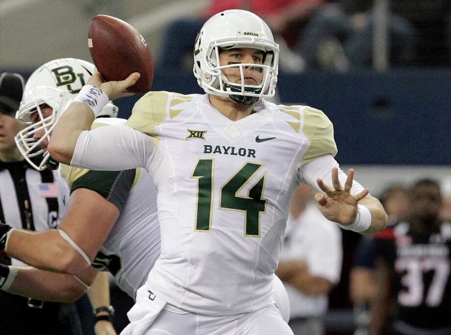 Baylor quarterback Bryce Petty throws against the Texas Tech during the first half against Texas Tech at AT&T Stadium in Arlington. After leading the Bears to their first two Big 12 championships, Petty wraps up his career Thursday in the Cotton Bowl against Michigan State. Photo: Tim Sharp /Associated Press / FR62992 AP