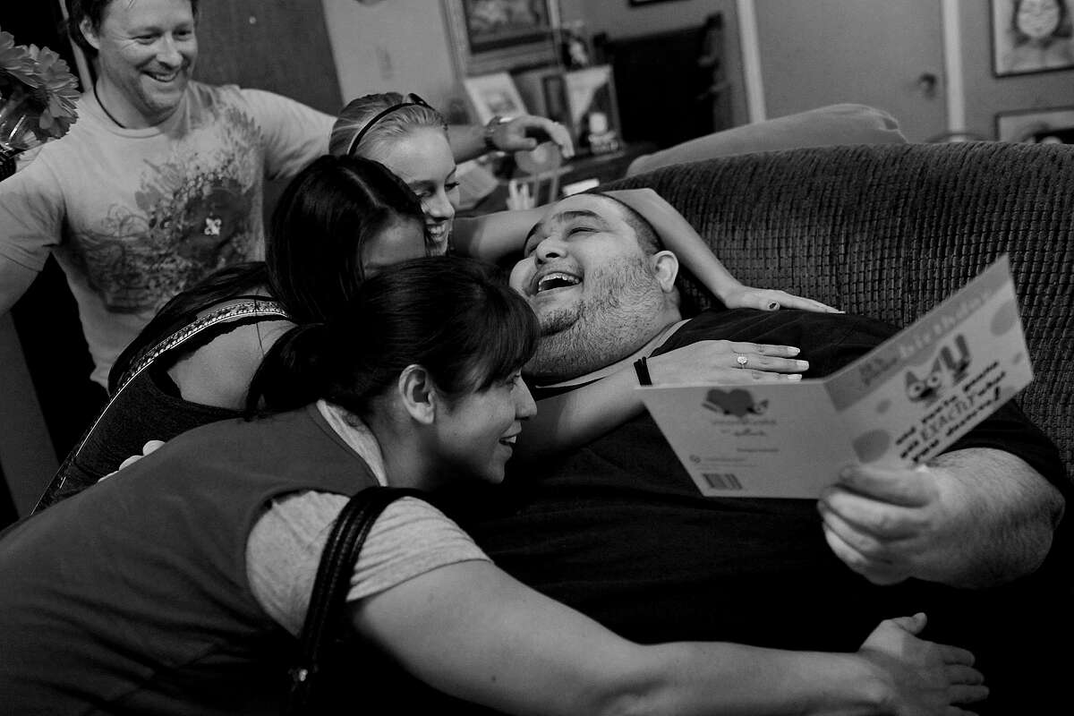 Hector Garcia Jr. gets a visit from his family to celebrate his 45th birthday on Nov. 20, 2010. His sister, Rebecca Freed, from front, her daughter, Lauren Ibarra, step-daughter, Brooke Freed, and Rebecca's husband, Tom Freed, brought him Gerber daisies, balloons and a card.