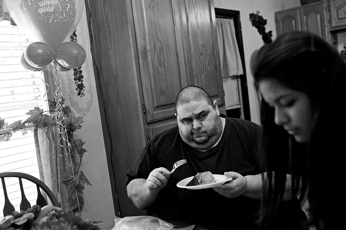 Hector Garcia Jr. is skeptical of the sugar-free cake his mother bought for him as he celebrates his 45th birthday with his niece, Lauren Ibarra.