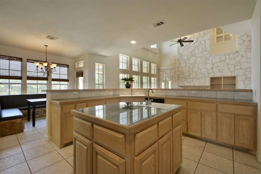 Tim Duncanput his nearly $1.2 million home in Spicewood up for sale at the asking price of $945,000 in December 2014. Thetwo-story, 3,955-square-foot Lake Travis homeincludes five bedrooms, four bathrooms, a double-height living room, a chef's kitchen with a center island, a game room and an office/study.