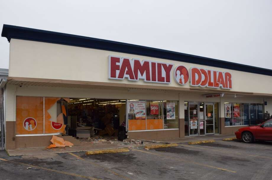 Emergency crews pulled an SUV out of a Family Dollar Store Wednesday morning on the South Side after a woman accidentally barreled in to the shop. Photo: Mark D. Wilson/San Antonio Express-News