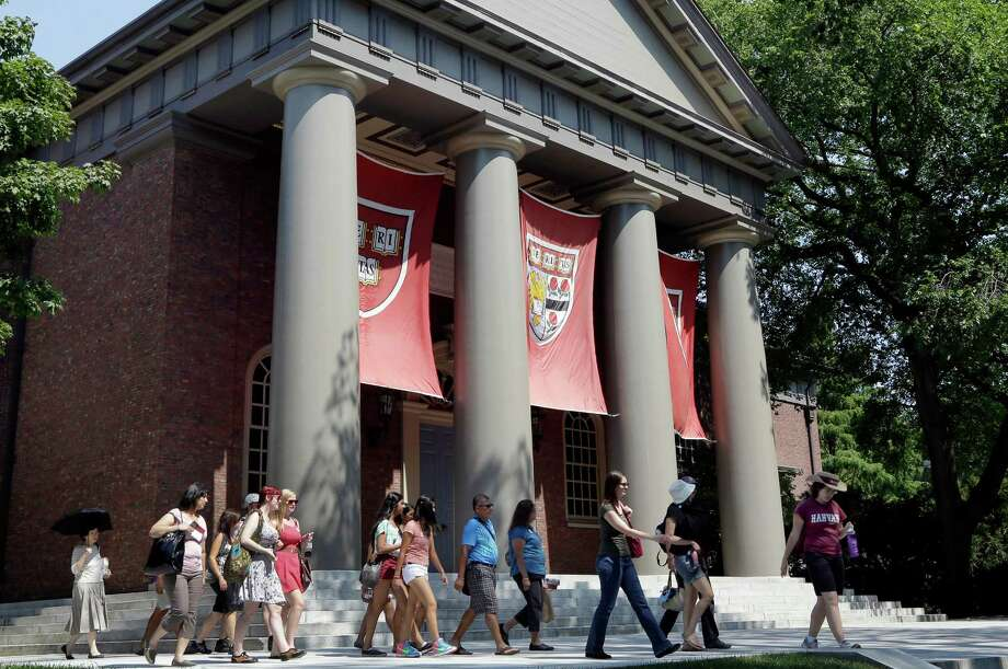 Potential students and their families tour Harvard University in Cambridge, Mass. The financial aid award letter, which outlines the grants, scholarships and loans available to a student, are not always easy to understand. Photo: Associated Press File Photo / AP