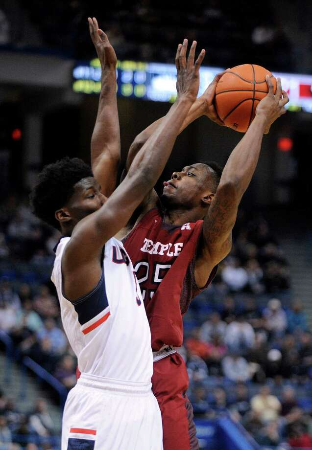 Temple's Quenton DeCosey (25) shoots over Connecticut's Daniel Hamilton (5) during the first half of an NCAA college basketball game in Hartford, Conn., on Wednesday, Dec. 31, 2014. Photo: Fred Beckham, AP / Associated Press