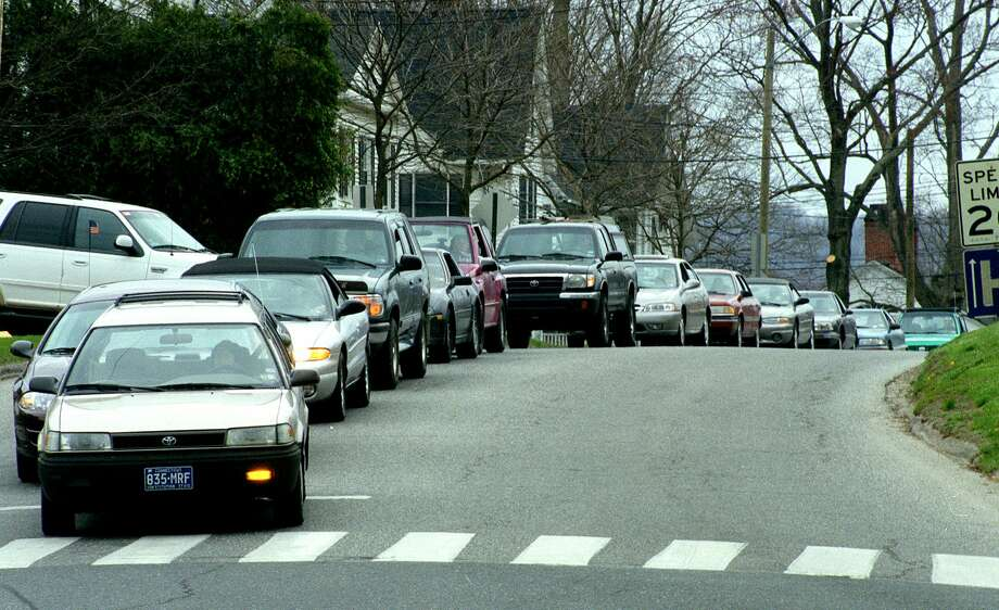 Crossing a street in any downtown area can be tricky, even in crosswalks. Photo: File Photo / The News-Times File Photo