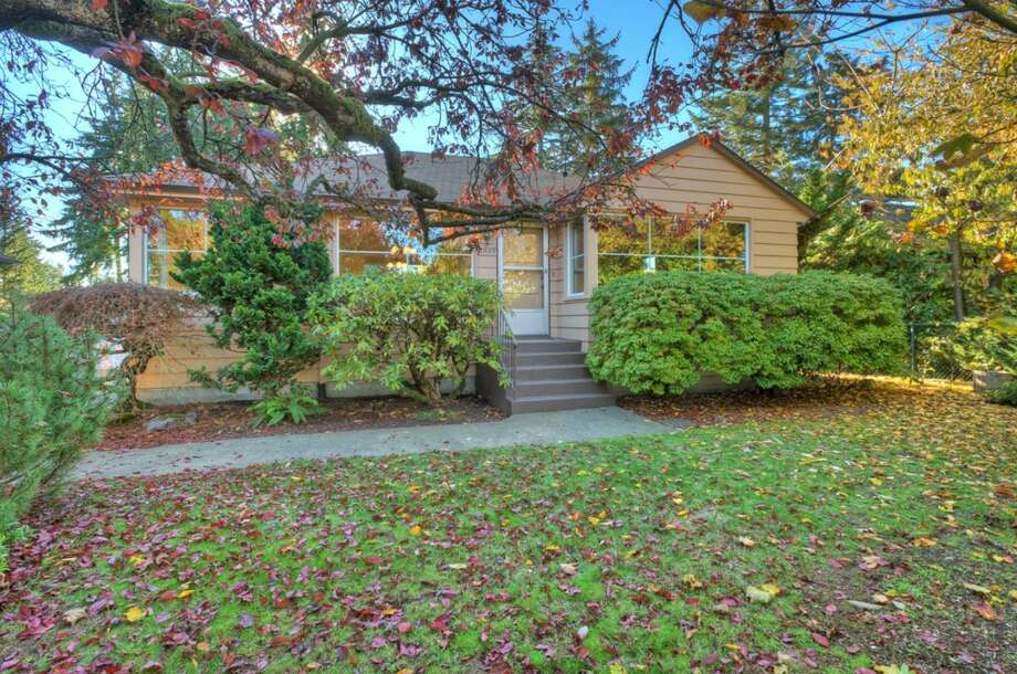 We'll start with the lowest priced home on our tour, 1909 N.E. Northgate Way, which is listed for $449,950. The 2,120-square-foot house, built in 1947, has three bedrooms, full and three-quarter bathrooms, two fireplaces and a family room on a 5,992-square-foot lot with a patio. An open house is scheduled for noon to 3 p.m. Sunday. Photo: Image Arts Photography,  Courtesy Norman Iverson,  RE/MAX On The Lake