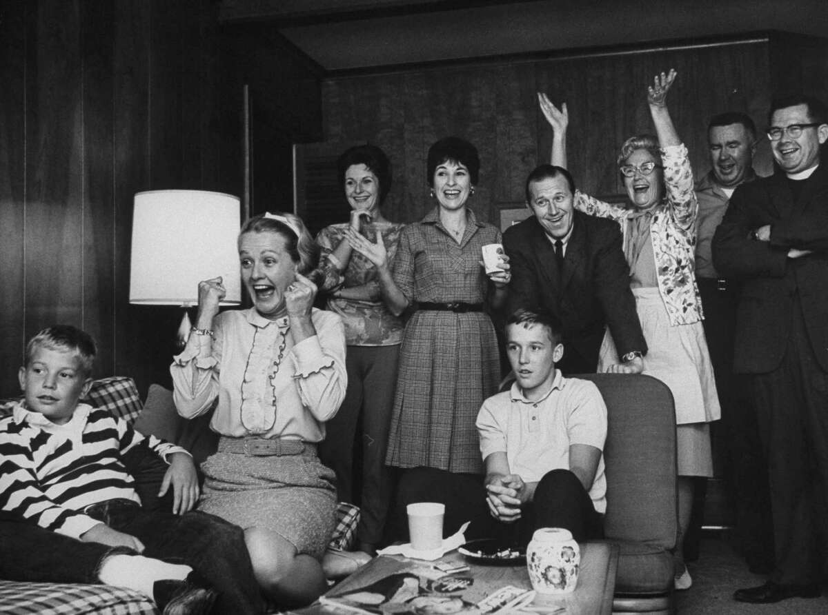 Astronaut's wife Sue Borman, second from left, cheering husband Frank's return from space.
