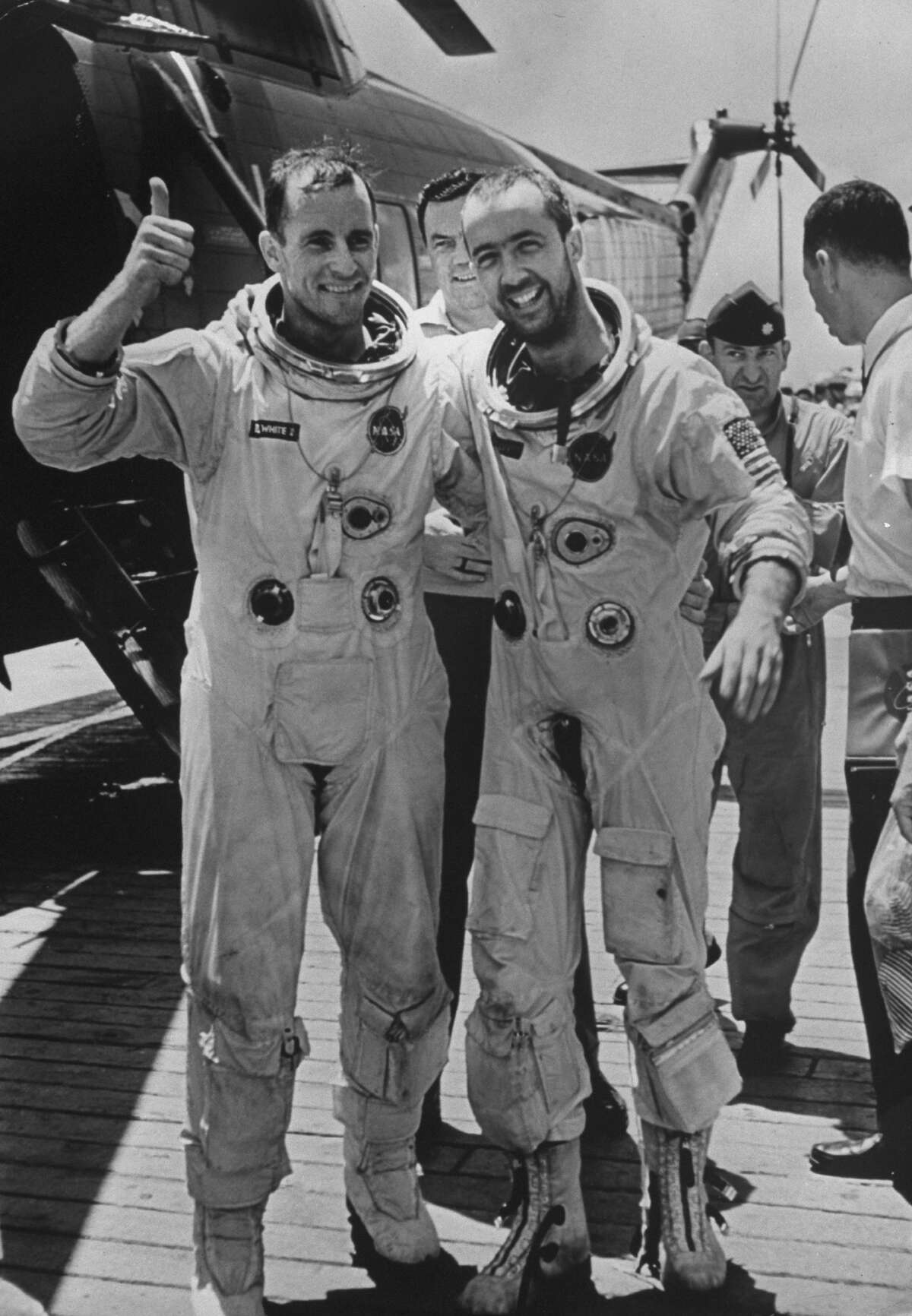 Astronauts Edward H. White, left, and James A. McDivitt make victorious