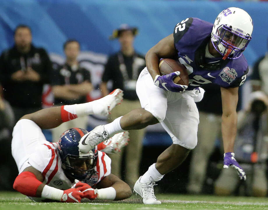 TCU running back Aaron Green (22) runs past Mississippi defensive back Kendarius Webster (15) during the first half of the Peach Bowl NCAA football game, Wednesday, Dec. 31, 2014, in Atlanta. (AP Photo/David Goldman) Photo: David Goldman, STF / Associated Press / AP