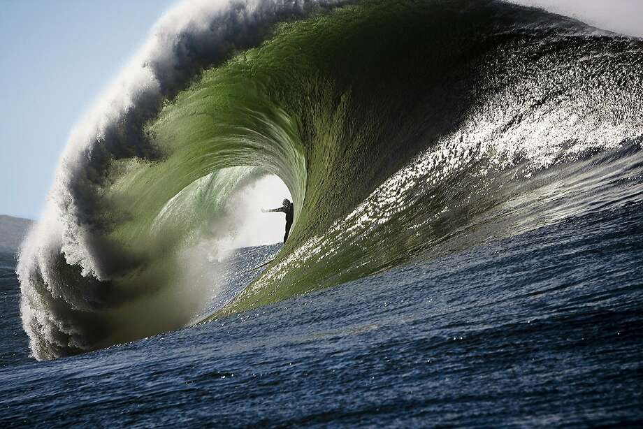 Surfer, Josh Loya shot looking through the barrel from the left at Mavericks. The image was featured on the cover of Surfing Magazine in the winter of 2009. Image by Frank Quirarte Photo: Frank Quirarte, Courtesy Of Frank Quirarte
