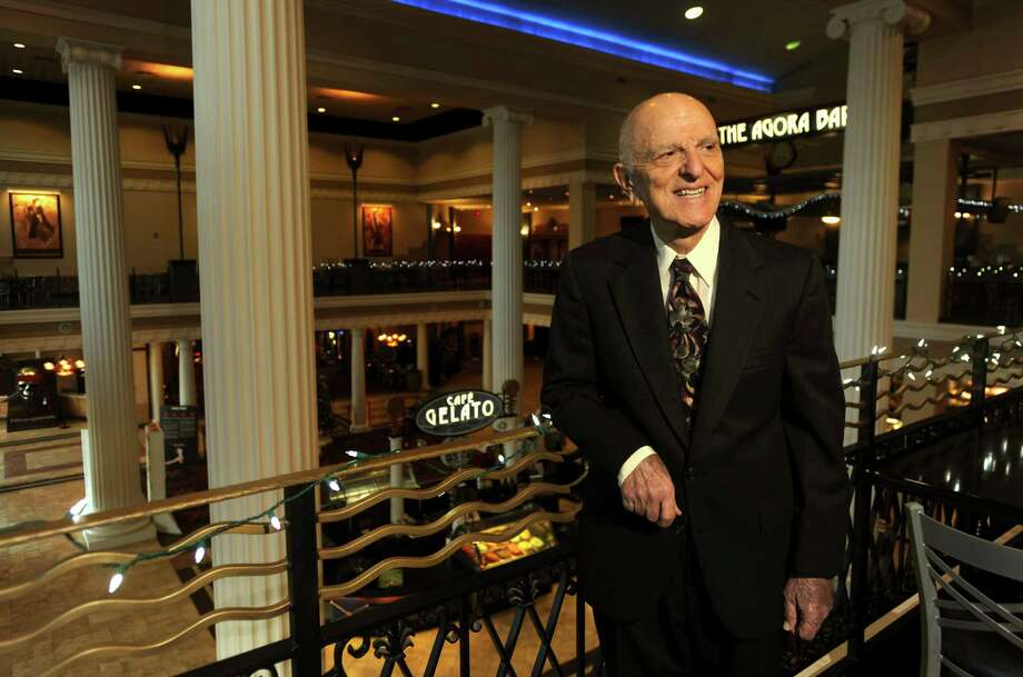 John Santikos is shown at the Palladium movie theater in 2010. Santikos pledged $605 million in assets and cash to the San Antonio Area Foundation upon his death. The transfer became official Thursday. Photo: Express-News File Photo / SAN ANTONIO EXPRESS-NEWS