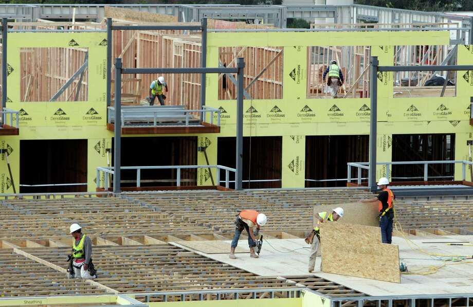 These residential units will be part of the River Oaks District development.  The number of apartment projects being started in the Houston area is expected to fall off considerably. Photo: Mayra Beltran, Staff / © 2014 Houston Chronicle