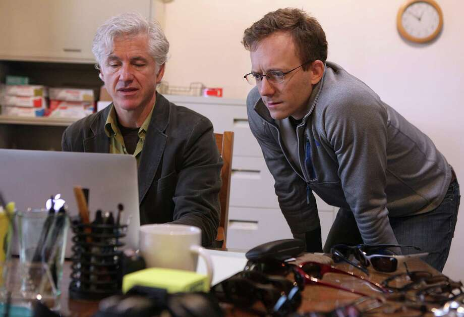 Vice presidents Don McPherson (left) and Andy Schmeder work at the EnChroma office in Berkeley. Photo: Liz Hafalia / The Chronicle / ONLINE_YES