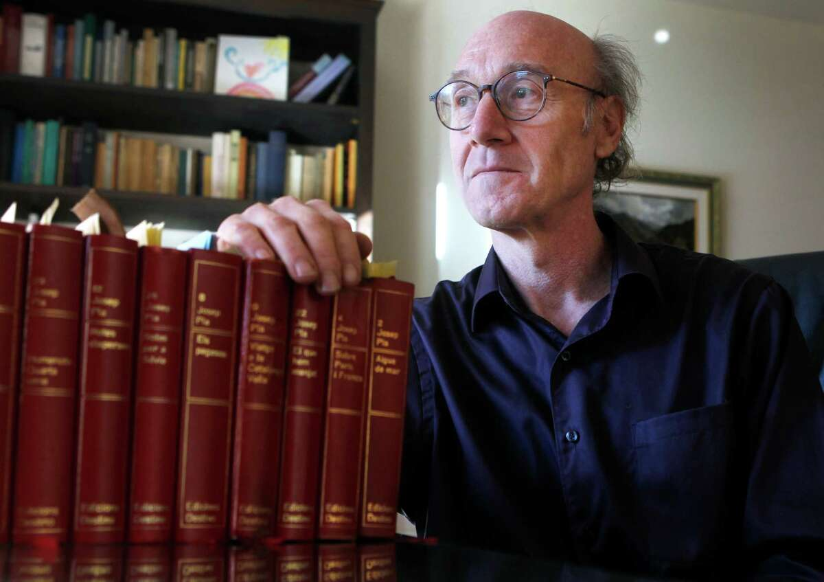 Stanford literature Professor Joan Ramon Resina, who is writing a book on Catalonian author Josep Pla, displays volumes of the writer's essays.