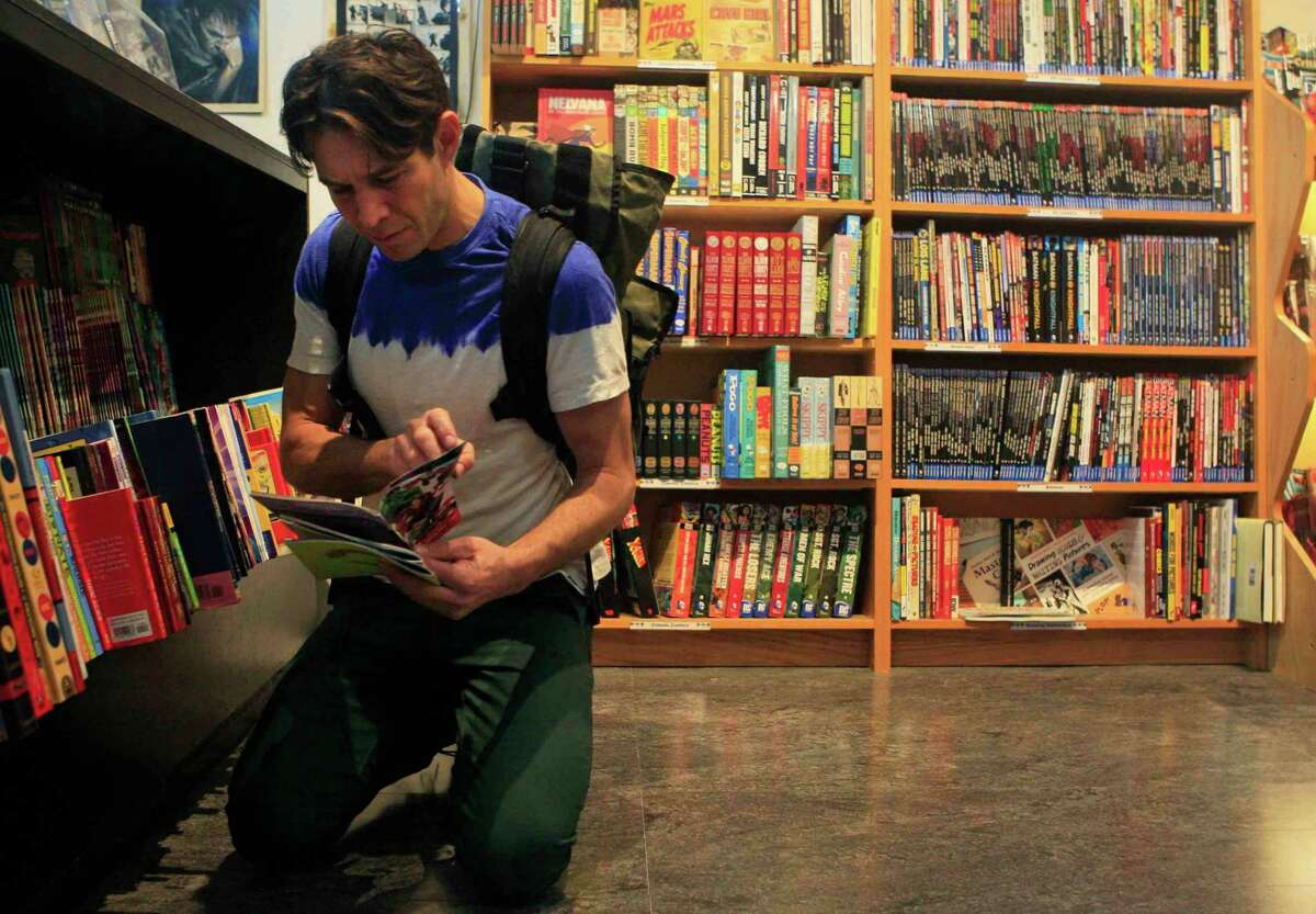 Dennis Budd of San Francisco picks out comic books at Comix Exchange on Divisadero Street in San Francisco, Calif. Wednesday, December 24, 2014.