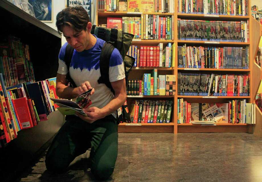 Dennis Budd of San Francisco picks out comic books at Comix Exchange on Divisadero Street in San Francisco, Calif. Wednesday, December 24, 2014. Photo: Jessica Christian / Special To The Chronicle / ONLINE_YES
