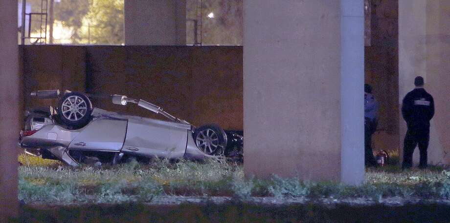 A car fell off the overpass along U.S. 59 after it collided with an HPD car on New Year's Eve. Photo: James Nielsen, Chronicle