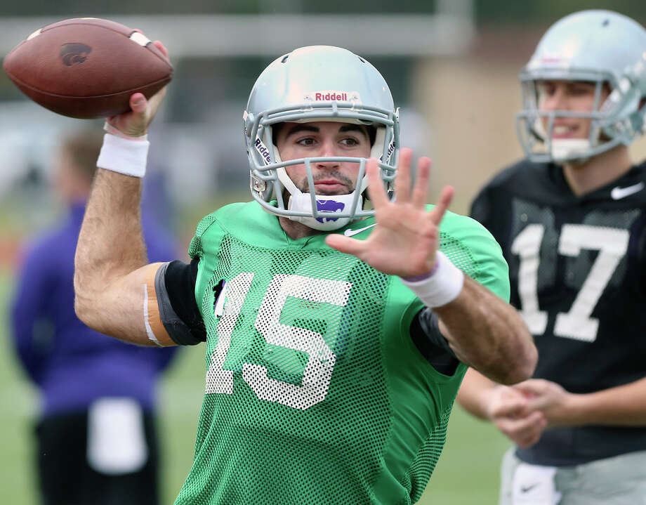 Quarterback Jake Waters warms up as Kansas State practices at Alamo Heights' Orem Stadium on Dec. 30, 2014, in preparation for the Valero Alamo Bowl. Photo: Tom Reel /San Antonio Express-News