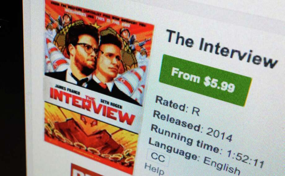 """FILE-In this Wednesday, Dec. 24, 2014 file photo, a computer screen shows Sony Pictures' film, """"The Interview"""" available for rental on YouTube Movies, in Los Angeles. Sony Pictures Entertainment says it is expanding the digital availability of """"The Interview"""" to top cable, satellite and telecom services, beginning Wednesday, Dec. 31, 2014, and increasing through the weekend. Starting Thursday, the movie will also be available on PlayStation Network. (AP Photo/Richard Vogel, File) Photo: Richard Vogel, STF / AP"""