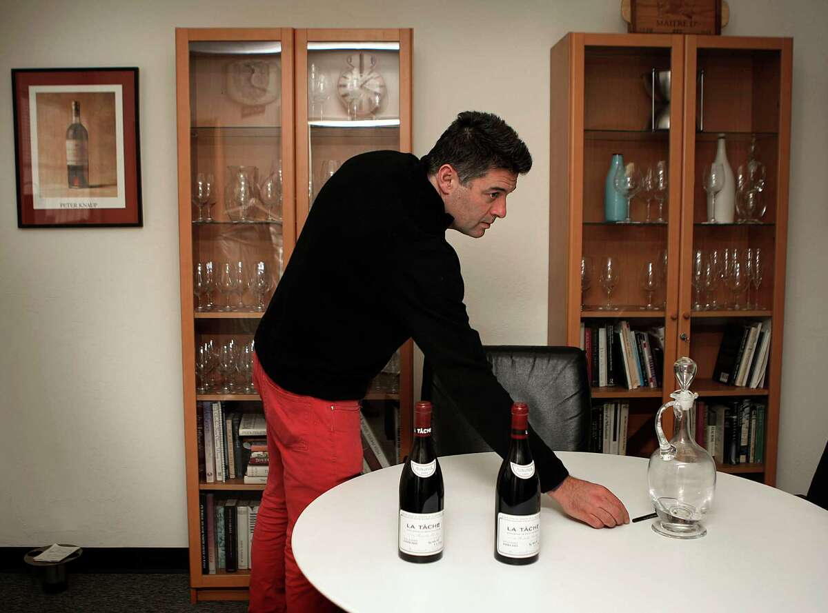 Justin Grover of Fine Wines International shows off bottles of La Tache in San Francisco in December.